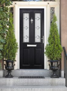 Black Front Door with White Door Frame and Greenery